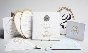 Luxury custom weight wedding invitation diamante brooch, gold gilded edge, gold raised ink, laser cut table names and menus