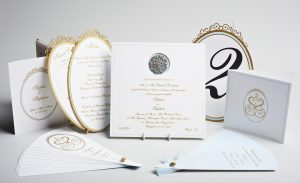 Luxury custom weight wedding invitation diamante brooch, gold gilded edge, gold raised ink, laser cut table names and menus