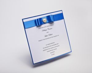 Luxury royal blue satin ribbon wedding invitation, embellished with heart shaped pearl and diamantes with Dior style bow