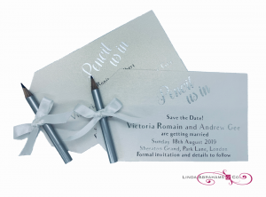 bespoke save the date cards with small pencil and ribbon 'pencil us in'