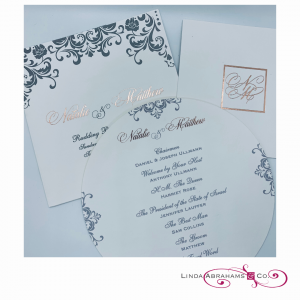 bespoke wedding invitation with pattern and rose gold foil print and circular menu