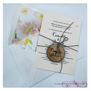 rustic wedding invitation with wooden plaque and lined envelopes