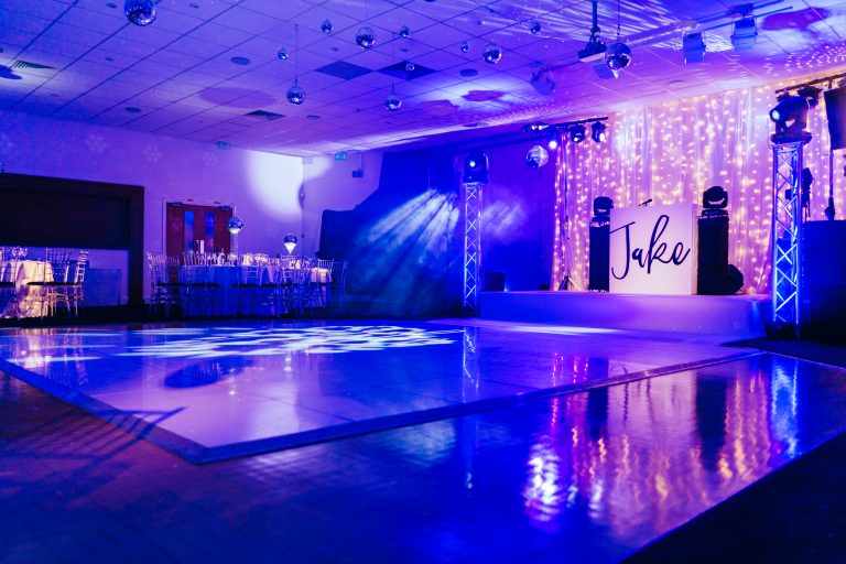 elegant white and blue themed barmitzvah with fairy lights and mirror balls