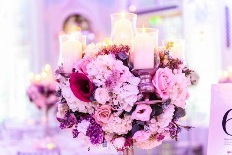 stunning lilac pink and purple floral wedding display at the savoy
