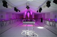 luxury white marquee with hanging chandeliers and lighting installation