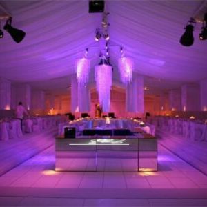 elegant white marquee with mirrored bar and hanging chandeliers