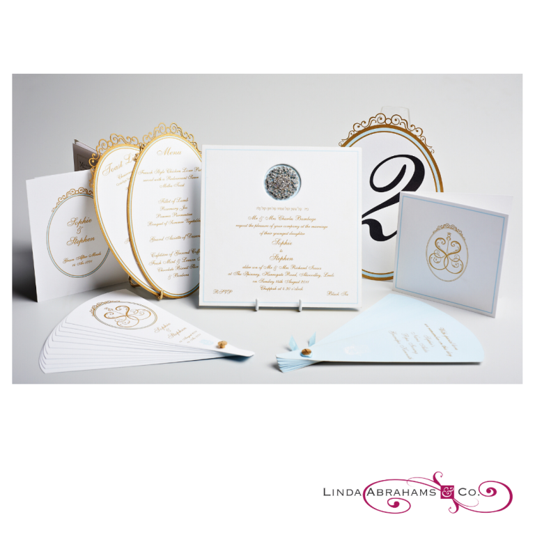 luxury invitation suite with gold raised ink laser cut details and diamante brooch