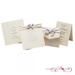Luxury ivory embossed invitation with hand dyed ribbon and silver raised ink