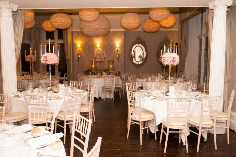 wedding at falcon manor ivory chivari chairs and pale pink roses and candelabras